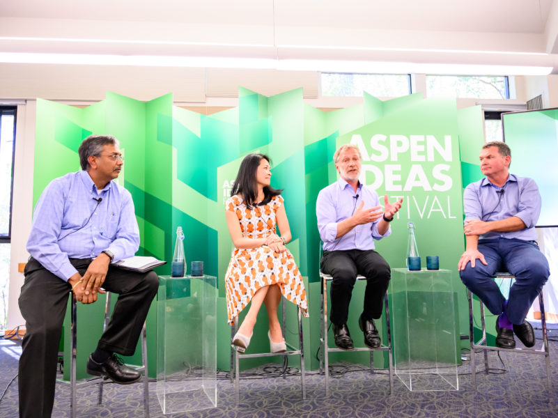 Four people are on stage at the aspen ideas festival