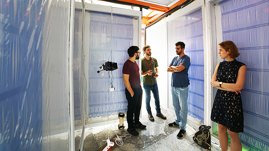 Eric Teitelbaum (center), speaks to visitors inside the Cold Tube pavilion in Singapore. (Photo courtesy of Lea Ruefenacht)